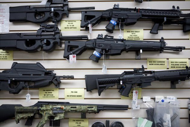 Semi-automatic weapons for sale are on display at a Texas gun dealer.