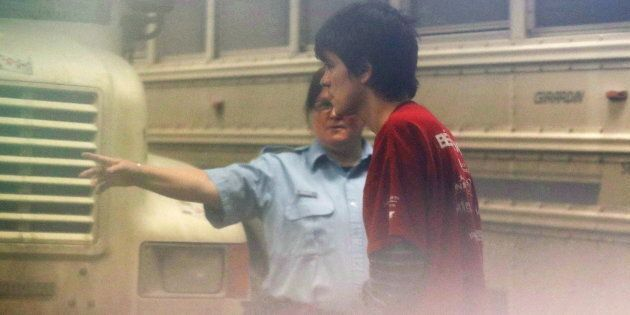 Alexandre Bissonnette, the suspect in a mass shooting at a mosque, arrives at the court house in Quebec...