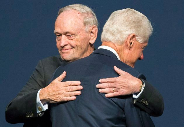 Former Canadian prime minister Jean Chretien hugs former U.S. president Bill Clinton in Montreal on Oct....