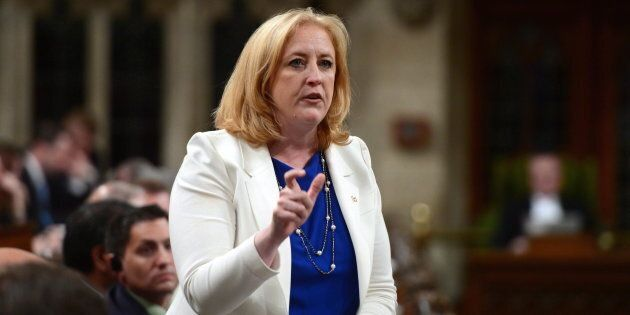 Conservative MP Lisa Raitt stands during question period in the House of Commons on June 8,