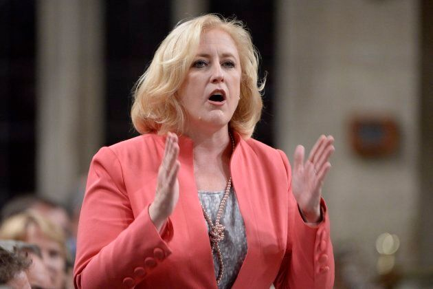 Conservative MP Lisa Raitt rises during question period in the House of Commons in Ottawa, Wed. Oct.4....