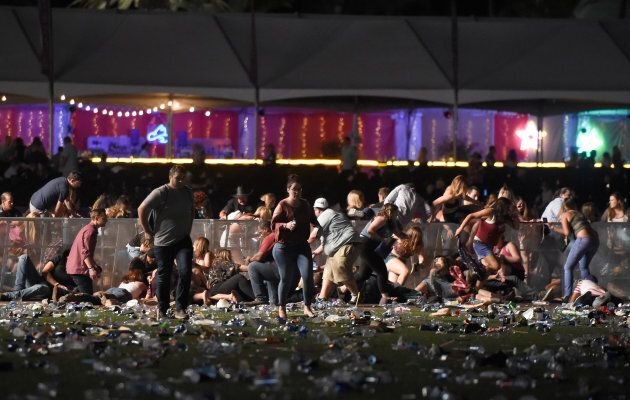 People run from the Route 91 Harvest country music festival after gun fire was heard on Oct. 1, 2017...