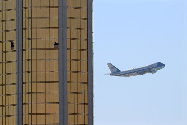 Air Force One departs Las Vegas past the broken windows on the Mandalay Bay hotel, where shooter Stephen...