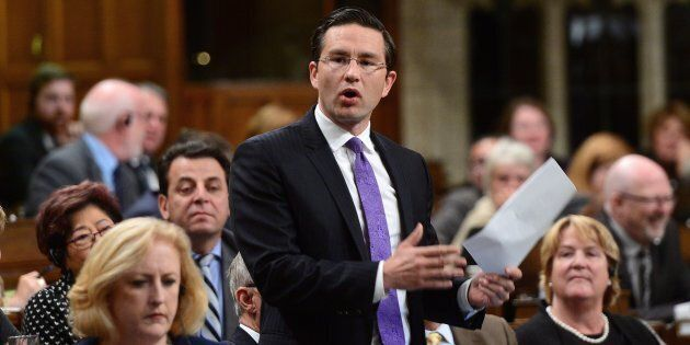 Conservative MP Pierre Poilievre stands during question period in the House of Commons on Parliament...
