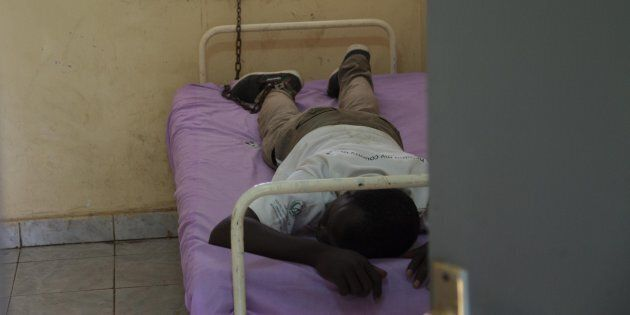 A chained mental patient is seen at the psychiatry department of Juba Education Hospital in Juba, South Sudan on October 11, 2016.