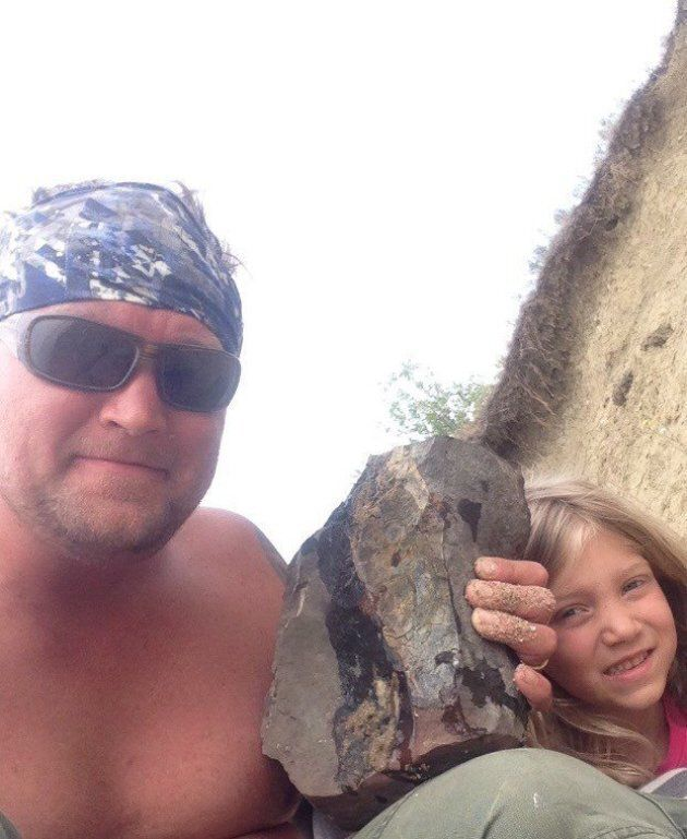 Jon Ganshorn and his daughter pose with a fossil in this recent handout