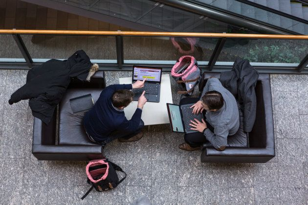 People work on laptop computers at the MaRS Discovery District building in Toronto, Ont.