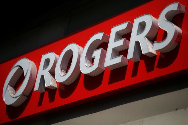 A sign is pictured outside a Rogers Communications retail store in Ottawa, July 20,