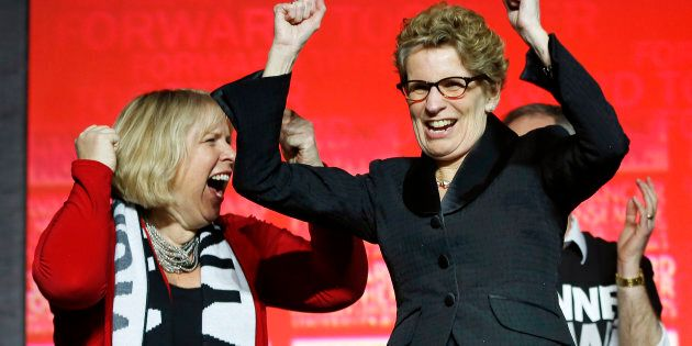 Kathleen Wynne cheers with Deb Matthews at the Ontario Liberal leadership convention in Toronto on Jan....