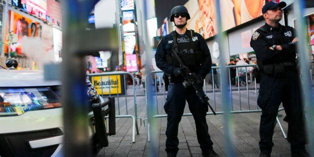 New York Police Department officers stand guard in Times Square on May 29,