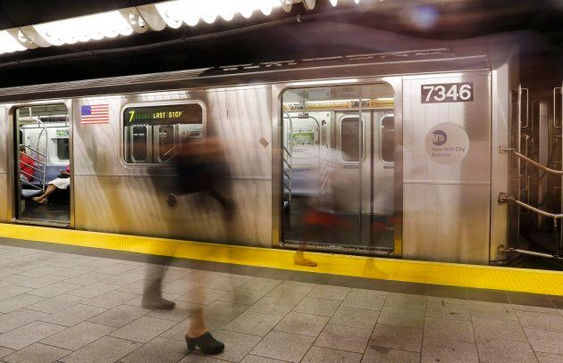 People walk on a subway platform in New York on June 22, 2016. The city's subway system was a target...