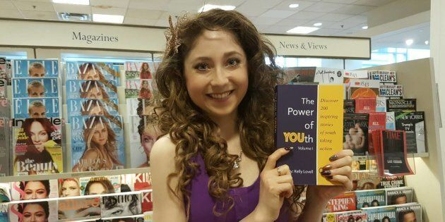 Kelly Lovell holding her latest book The Power of YOUth, which is filled with 200 stores of young entrepreneurs...