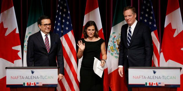 Foreign Minister Chrystia Freeland in between Mexico's Economy Minister Ildefonso Guajardo and U.S. Trade...