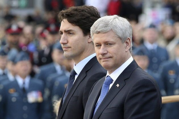 Stephen Harper and Justin Trudeau take part in a ceremony to commemorate the October 2014 attack on Parliament...