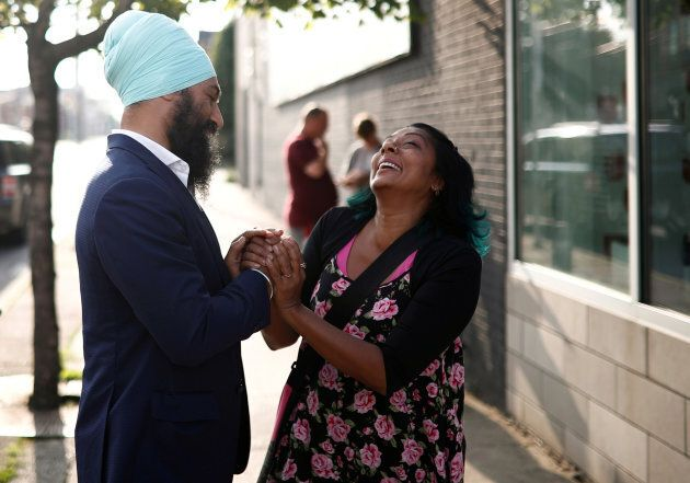New Democratic Party federal leadership candidate Jagmeet Singh shakes hands with a woman at a meet and...