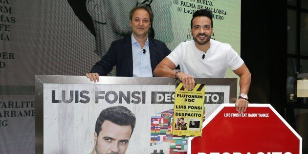 Luis Fonsi (R) presents his 'Love + Dance World Tour' and receives an award from the hands of Narcis...