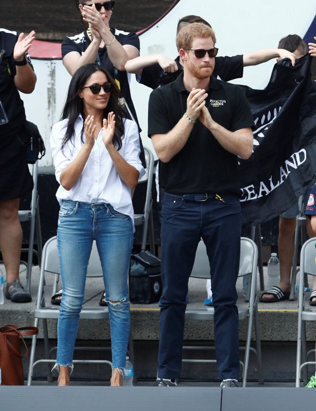 Prince Harry and actress Meghan Markle watch the wheelchair tennis event during the Invictus Games in...