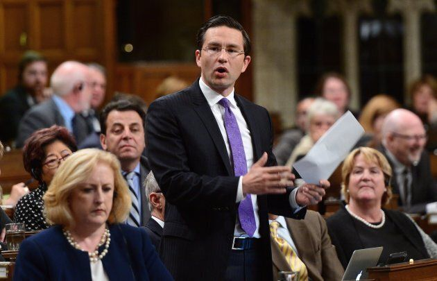 Conservative MP Pierre Poilievre stands during question period in the House of Commons on Parliament Hill in Ottawa on Thursday, Oct. 5. Poilievre is criticizing a Canada Revenue decision to tax employee discounts.