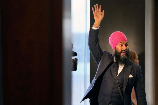 Jagmeet Singh waves to supporters as he walks into a hotel ballroom for the New Democratic Party leadership...
