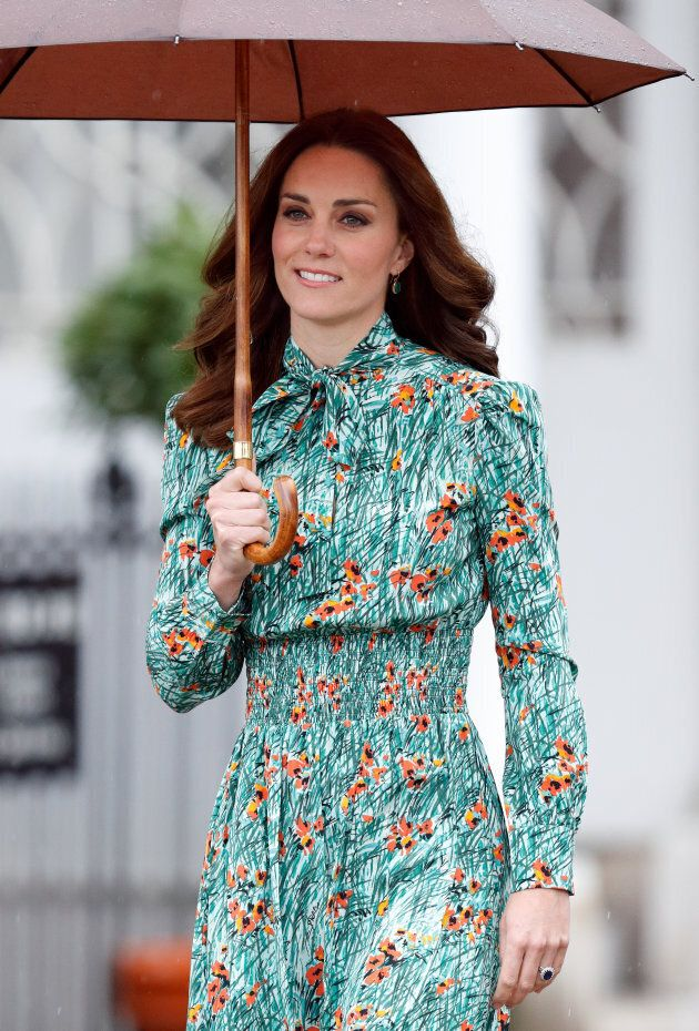 Catherine, Duchess of Cambridge visits the Sunken Garden in the grounds of Kensington Palace on August...