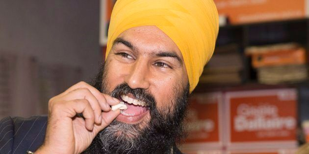 NDP Leader Jagmeet Singh samples a famous Lac-St-Jean curd cheese during a campaign visit for local candidate Gisele Dallaire on Oct. 10, 2017 in Alma, Que.