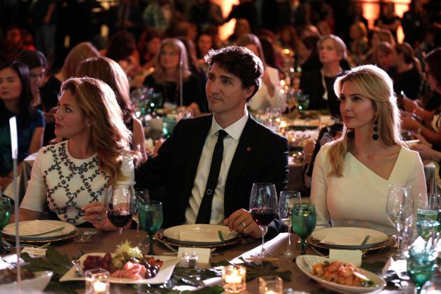 Prime Minister Justin Trudeau, his wife Sophie and Senior White House Advisor Ivanka Trump sit together...