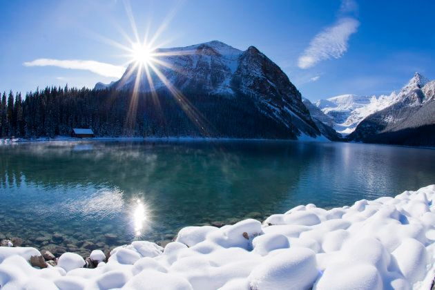 The sun shines over Lake Louise,