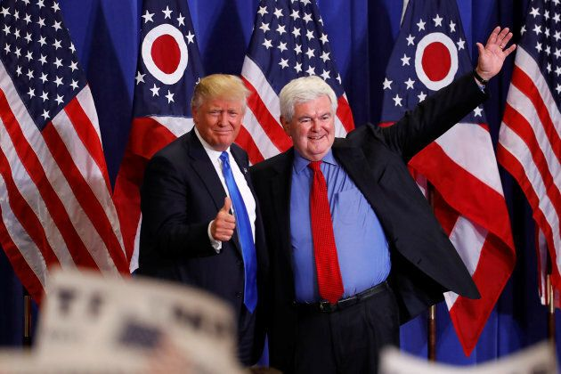 Former Speaker of the House Newt Gingrich greets Donald Trump at a rally in Cincinnati, Ohio on July...