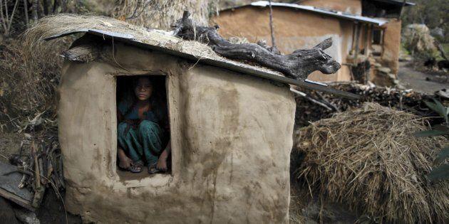 Uttara Saud, 14, sits inside a chaupadi shed in the hills of Legudsen village in Achham District in western...