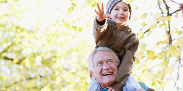 A grandfather carries his grandson on his shoulders. A new study finds that people who lived close to trees or vegetation had an eight to 12 per cent reduced risk of dying compared to those that didn't.