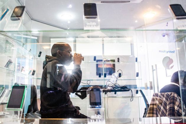 A tech entrepreneur works at a technology innovation center in Nairobi,