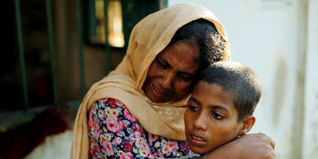 Rashida, 10, and her mother, who survived after a boat capsized, while five of their family members are...