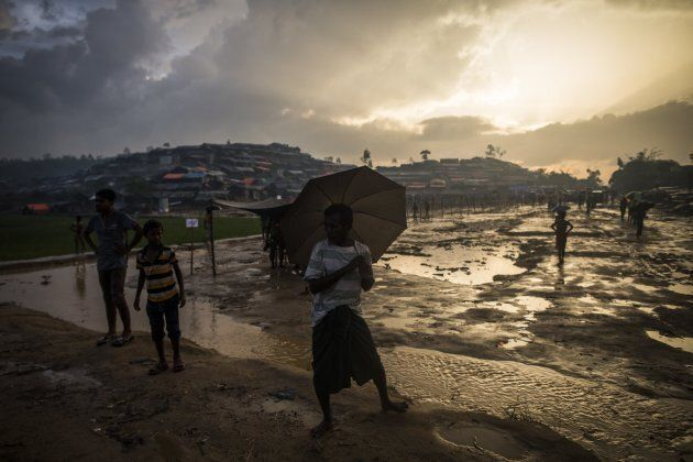 Rohingya people are seen during a rainy day at the Tankhali makeshift camp in Cox's Bazar, Bangladesh...
