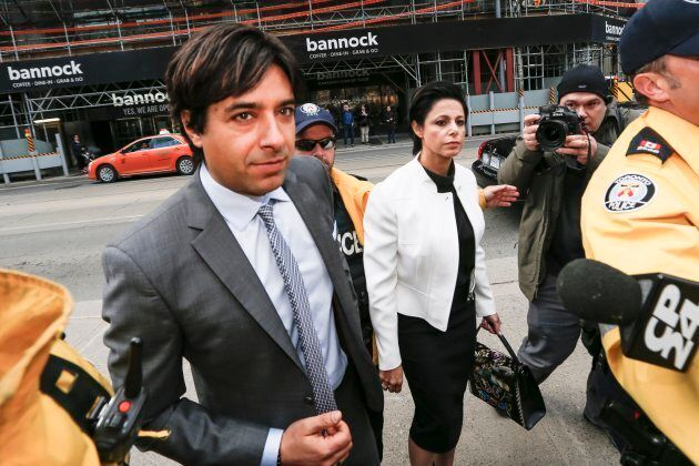 Jian Ghomeshi and his lawyer Marie Henein arrive at Old City Hall