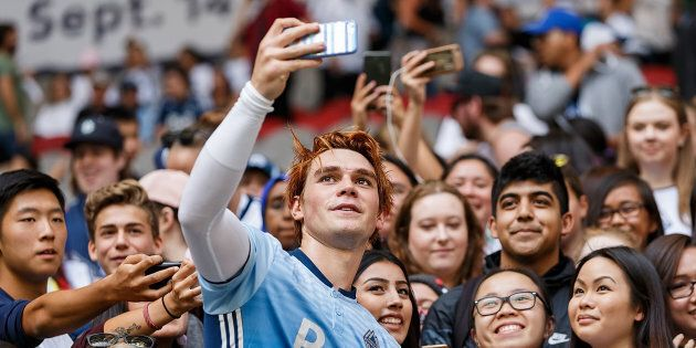 KJ Apa takes a selfie with fans after the Legends And Stars: Whitecaps FC Charity Alumni match at BC...