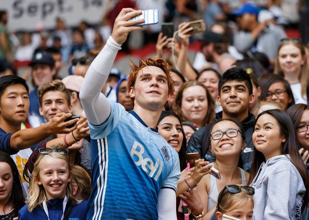 Actor KJ Apa takes a selfie with fans after the Legends And Stars: Whitecaps FC Charity Alumni match...