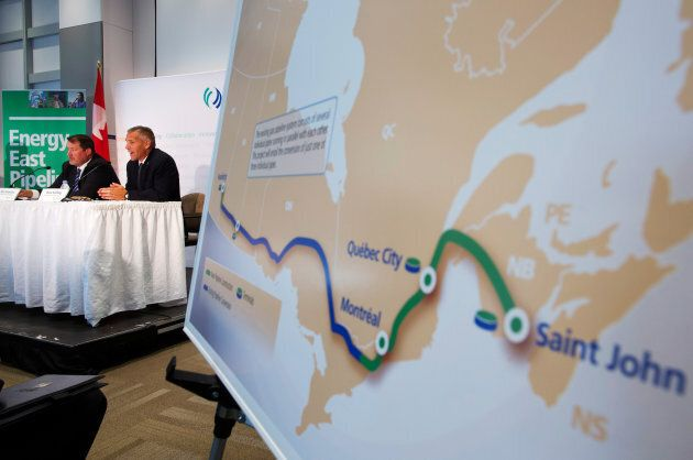 TransCanada President and CEO Russ Girling, right, announces the Energy East Pipeline during a news conference...