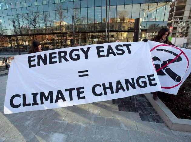 Members of Stop Energy East Halifax protest outside the library in Halifax on Jan. 26,
