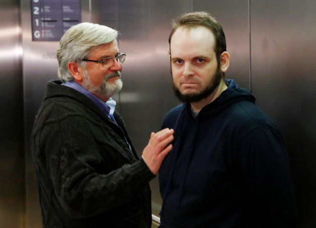 Joshua Boyle stands next to his father Patrick Doyle after arriving with his wife and three children...