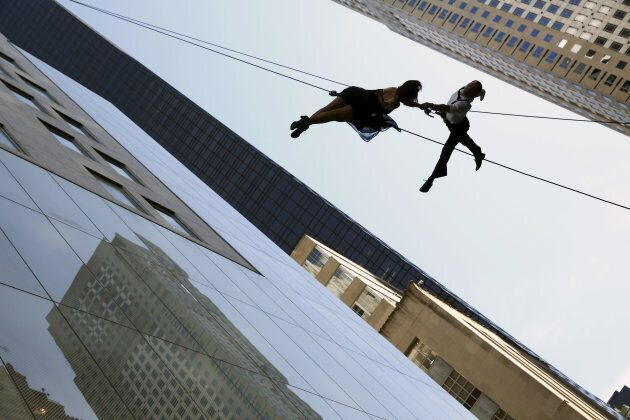 Dancers rappel down the side of a building as part of a performance in New York City, New York on April...