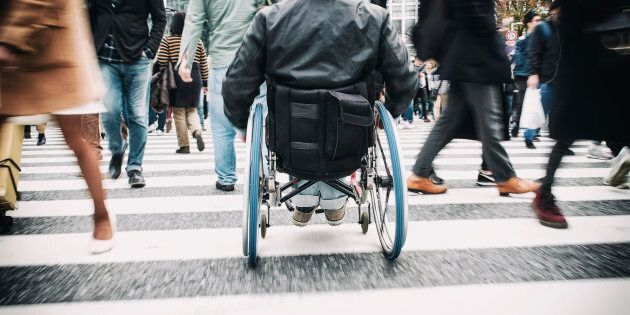 A Japanese man is shown in a wheelchair in Tokyo, Japan. Canada's first national accessibility legislation...