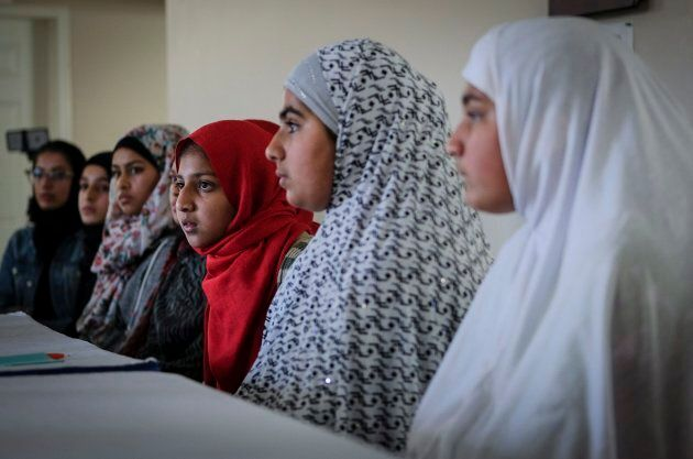 Young girls listen to Imam Syed Soharwardy at a Calgary mosque on Oct. 6,