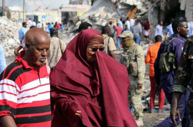 A Somali woman mourns at the scene of an explosion in KM4 street in the Hodan district of Mogadishu,...