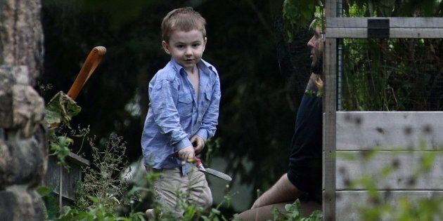 Joshua Boyle and his son Jonah play in the garden at his parents' house in Smiths Falls, Ont., Oct. 14, 2017.