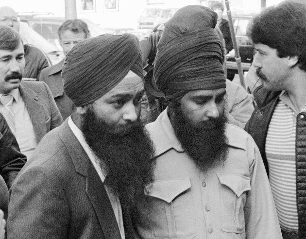 Inderjit Singh Reyat and Talwinder Singh Parmar enter the courthouse in Duncan, B.C. on Nov. 8,
