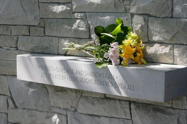 Flowers are left at the Air India memorial in Vancouver on July 27,
