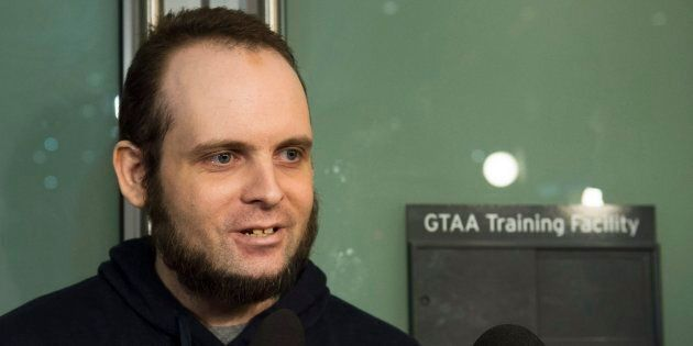 Joshua Boyle speaks to the media after arriving at the airport in Toronto on Oct. 13, 2017. Boyle, his...
