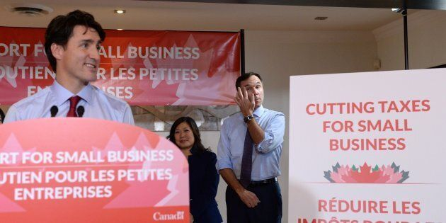 Prime Minister Justin Trudeau speaks to members of the media as Finance Minister Bill Morneau looks on at a press conference on tax reforms in Stouffville, Ont., on Oct.  16, 2017.