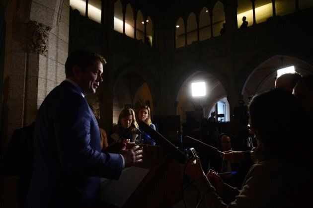 Conservative Leader Andrew Scheer speaks to reporters in the foyer of the House of Commons on Oct. 16,