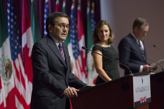 Ildefonso Guajardo Villarreal, Mexico's secretary of economy, speaks while Minister of Foreign Affairs...
